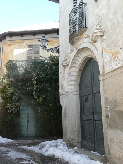 Characteristic cobbled side street of Vacciago, with art deco ironwork (winter picture, taken 15/2/2012)